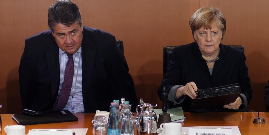 German Chancellor Angela Merkel, right, and Vice Chancellor and Economy Minister Sigmar Gabriel arrive for the weekly cabinet meeting of the German government at the chancellery in Berlin, Wednesday, Oct. 5, 2016. (AP Photo/Markus Schreiber)
