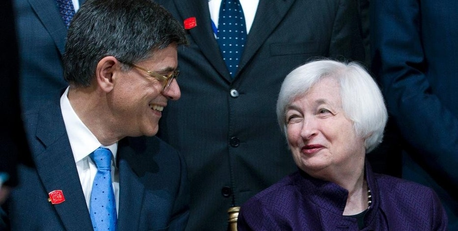 Treasury Secretary Jacob Lew speaks with Federal Reserve Chair Janet Yellen at the G-20 group photo, during the World Bank/IMF Annual Meetings at IMF headquarters in Washington, Thursday, Oct. 6, 2016. ( AP Photo/Jose Luis Magana)