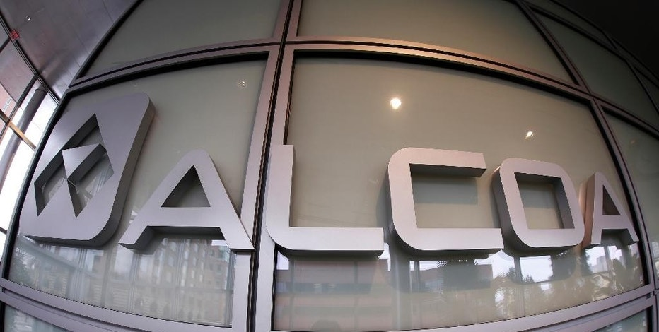 FILE - This April 7, 2014, file photo shows the Alcoa logo in the lobby of the company's headquarters in Pittsburgh. On Tuesday, Oct. 11, 2016, Alcoa reports financial results. (AP Photo/Gene J. Puskar, File)