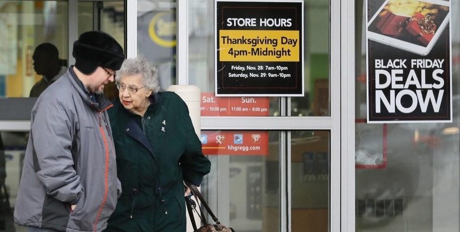 FILE - In this Tuesday, Nov. 25, 2014, file photo, a man and a woman leave an Hhgregg store in Mayfield Heights, Ohio. Consumer electronics chain Hhgregg Inc. has become the latest retailer to take a stand against Thanksgiving shopping and plans to close its doors for the turkey feast, announced Tuesday, Oct. 11, 2016. (AP Photo/Tony Dejak, File)