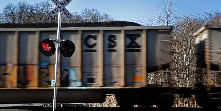 FILE - In this March 22, 2014, file photo, a CSX freight train rolls past a grade crossing in Mount Airy, Md. CSX Corp. on Wednesday, Oct. 12, 2016, reported better-than-expected net income in the third quarter even as coal volumes continued double-digit declines. (AP Photo/Patrick Semansky, File)