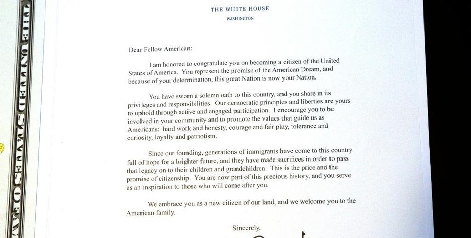 This Friday, Sept. 16, 2016, photo, taken in Cary, N.C., shows a letter from the White House welcoming Manasi Gopala as a U.S. citizen, signed by President Barack Obama. Gopala left her birthplace of Bangalore, India in 2002, even as many Americans lamented the outsourcing of tech jobs to that city. She became a citizen in 2013 and bought a suburban home a few months ago. (AP Photo/Gerry Broome)