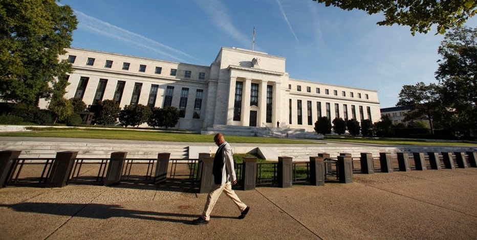 A man walks past the U.S. Federal Reserve in Washington October 12, 2016. REUTERS/Kevin Lamarque