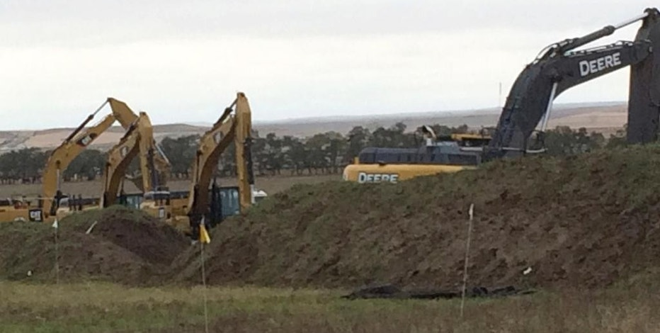 Excavators are in place as work resumed Tuesday, Oct. 11, 2016, on the four-state Dakota Access pipeline near St. Anthony, N.D. A federal appeals court ruling on Sunday cleared the way for work to resume on private land in North Dakota that's near a camp where thousands of protesters supporting tribal rights have gathered for months. (AP Photo/ Blake Nicholson)
