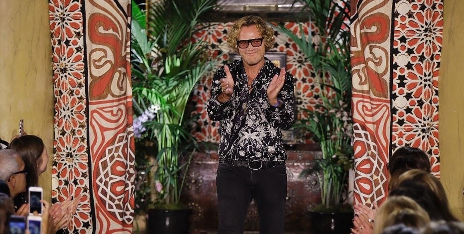 FILE - In this Wednesday, Sept. 21, 2016 file photo, Roberto Cavalli fashion house creative director Peter Dundas acknowledges the applause of the audience after presenting the Roberto Cavalli women's Spring-Summer 2017 collection, in Milan, Italy. Roberto Cavalli CEO Giacomo Ferraris said Wednesday, Oct. 12, 2016, that Dundas, who took over in March 2015, is leaving the house, as it's going through a period of transformation and that a new creative director will be named. (AP Photo/Luca Bruno)