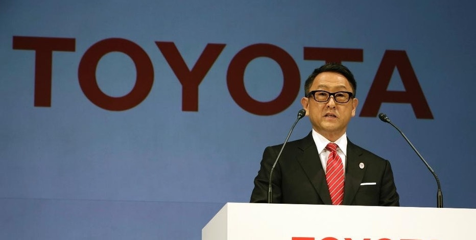 """FILE- In this March 13, 2015 file photo, Toyota President and CEO Akio Toyoda speaks during a press conference in Tokyo. Toyota, the world's top automaker, and Suzuki, a Japanese rival that specializes in tiny vehicles, are tying up in a partnership. Both sides announced in a joint statement Wednesday, Oct. 12, 2016, they will study areas they can work together in developing technology for the environment, safety and information networking. Toyoda said survival depends on such collaborations, and it was not enough for a company to be doing just its own research. """"It is very important now to have partners who share the same goal and passion,"""" he said. (AP Photo/Eugene Hoshiko, File)"""