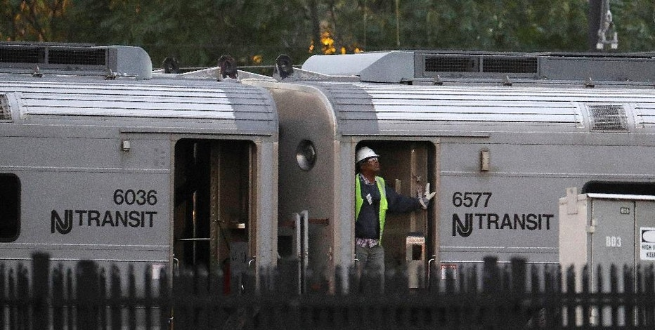 FILE - In this Oct. 6, 2016 file photo, a New Jersey Transit employee rides on a train as it is moved out of the Hoboken Terminal  in Hoboken, N.J., a week after the train crashed into the station, killing one person and injuring more than 100 people.  Trains run by New Jersey Transit, which operates the nation's second-largest commuter railroad, have been involved in 157 accidents since the start of 2011, three times as many as the largest, the Long Island Rail Road, according to an Associated Press analysis of data from January 2011 through July 2016.  (AP Photo/Julio Cortez)