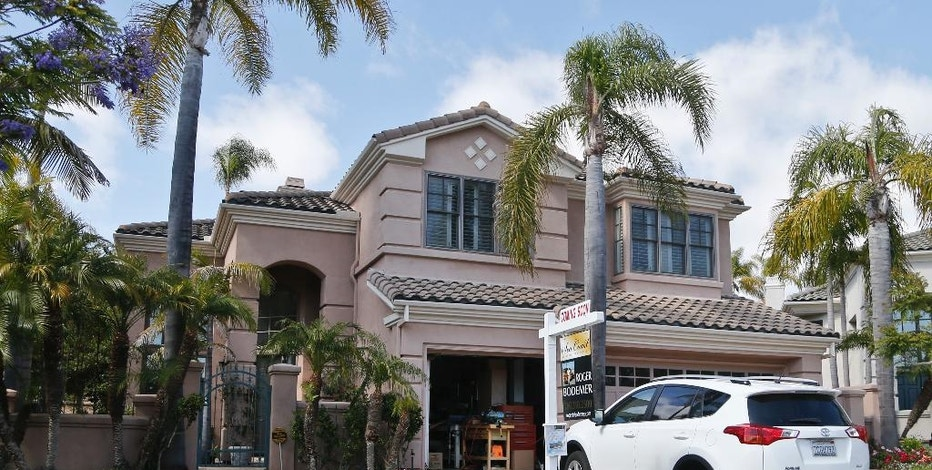 FILE - This Thursday, May 26, 2016, file photo shows a home for sale in Carlsbad, Calif. On Thursday, Oct. 13, 2016, Freddie Mac reports on the week's average U.S. mortgage rates. (AP Photo/Lenny Ignelzi, File)