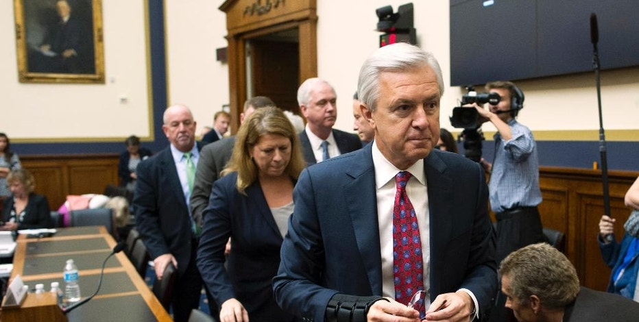 FILE - In this Thursday, Sept. 29, 2016, file photo, Wells Fargo CEO John Stumpf leaves a hearing room on Capitol Hill in Washington,  after testifying before the House Financial Services Committee investigating Wells Fargo's opening of unauthorized customer accounts. Embattled CEO Stumpf is out effective immediately, with President and Chief Operating Officer Tim Sloan taking over as the head of the one of the nation's largest banks, the company announced Wednesday, Oct. 12, 2016. (AP Photo/Cliff Owen)