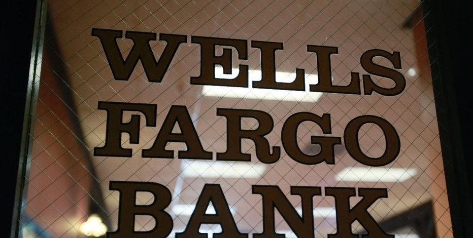 FILE - This April 19, 2010, file photo, shows a Wells Fargo Bank in Palo Alto, Calif. Ohio's Republican Gov. John Kasich announced Friday, Oct. 14, 2016, that he was suspending Wells Fargo from doing business with state agencies, and excluding the bank from participating in any state bond offerings. The bank has been under fire after allegations came to light that Wells employees may have opened up to 2 million customer accounts fraudulently in order to meet sales goals. (AP Photo/Paul Sakuma, File)