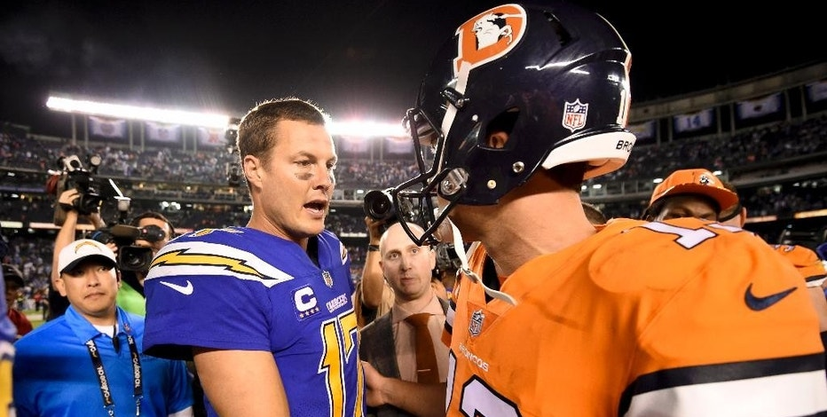 San Diego Chargers quarterback Philip Rivers, left, greets Denver Broncos quarterback Trevor Siemian after an NFL football game Thursday, Oct. 13, 2016, in San Diego. The Chargers won 21-13. (AP Photo/Denis Poroy)