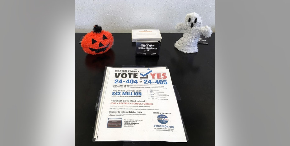 A flyer at a marijuana dispensary in Salem, Oregon, on Oct. 11, 2016 urges voters to approve marijuana businesses in unincorporated areas of Marion County. Some 50 counties and municipalities in Oregon have marijuana measures on the ballot for the Nov. 8, 2016 elections, two years after Oregonians passed a recreational marijuana ballot measure, but leaving local communities the ability to opt out. (AP Photo/Andrew Selsky)
