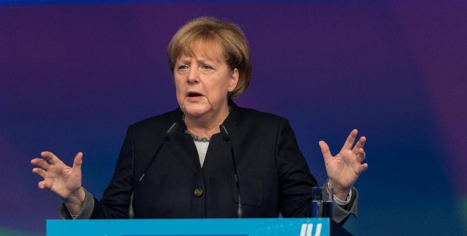 German chancellor Angela Merkel delivers a speech at the meeting of her Christian Democrats' Youth Organization. JU,  in Paderborn, Germany, Saturday Oct. 15, 2016.  Chancellor Angela Merkel says Germany wants friendly ties with Britain but won't drop its insistence that London can only enjoy full access to the European Union's internal market if it allows free immigration of EU citizens.  British Prime Minister Theresa May, who hasn't yet formally triggered EU exit talks, appears prepared to prioritize immigration controls.   ( Guido Kirchner/dpa via AP)
