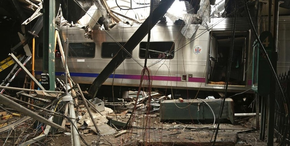 FILE - This Oct. 1, 2016, file photo provided by the National Transportation Safety Board shows damage done to the Hoboken Terminal in Hoboken, N.J., after the Sept. 29 commuter train crash. New Jersey Transit has said six more tracks will open at 4 a.m. Monday, Oct. 17, at Hoboken Terminal, that has resumed its operations on Oct. 10. It also noted that the station's ticket office has resumed operations. (Chris O'Neil/NTSB photo via AP, File)
