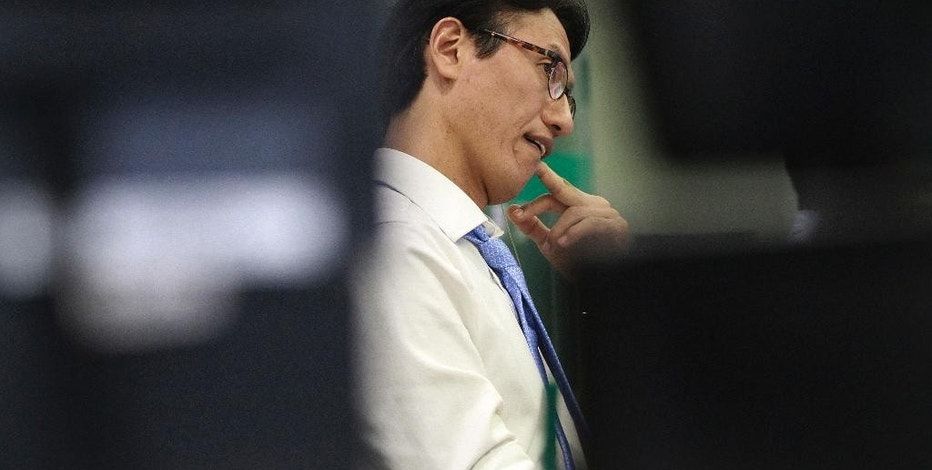 A currency trader watches monitors at the foreign exchange dealing room of the KEB Hana Bank headquarters in Seoul, South Korea, Monday, Oct. 17, 2016. Asian shares were mostly lower on Monday, trading within a narrow range as cautious investors considered the most recent comments by Federal Reserve Chair Janet Yellen. (AP Photo/Ahn Young-joon)
