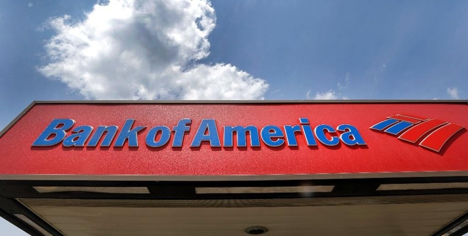 This Monday, July 18, 2016, photo shows the top of a Bank of America ATM booth, in Woburn, Mass. Bank of America is scheduled to report financial results, Monday, Oct. 17, 2016. (AP Photo/Elise Amendola)