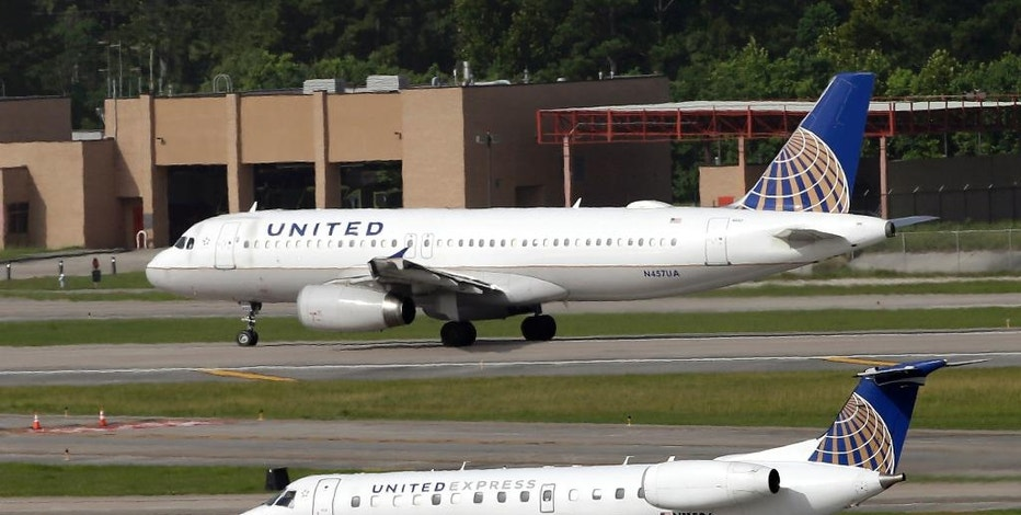 FILE - In this July 8, 2015, file photo, United Airlines and United Express planes prepare to take off at George Bush Intercontinental Airport in Houston. United Continental reports financial results Monday, Oct. 17, 2016. (AP Photo/David J. Phillip, FIle)