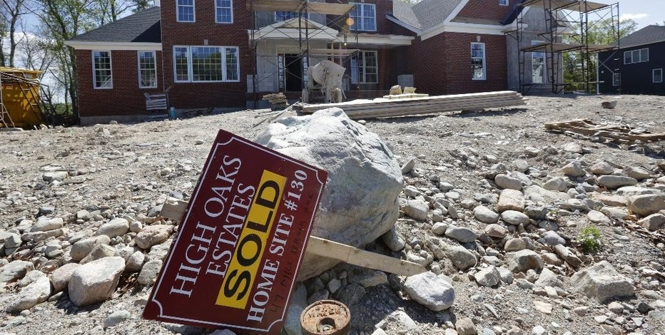 "FILE - In this Wednesday, May 18, 2016, file photo, a ""Sold"" sign rests in front of a house under construction, in Walpole, Mass. On Tuesday, Oct. 18, 2016, the National Association of Home Builders/Wells Fargo releases its October index of builder sentiment. (AP Photo/Steven Senne, File)"