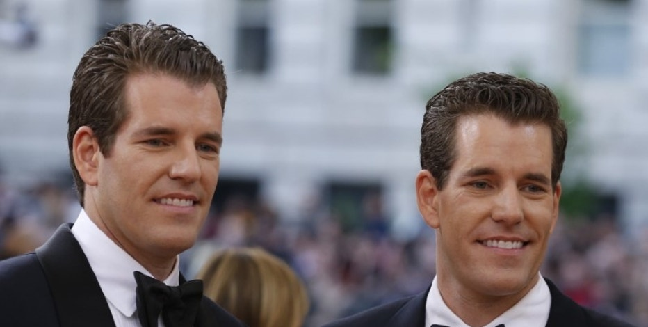 "Entrepeneurs Tyler and Cameron Winklevoss arrive at the Metropolitan Museum of Art Costume Institute Gala (Met Gala) to celebrate the opening of ""Manus x Machina: Fashion in an Age of Technology"" in the Manhattan borough of New York, May 2, 2016. REUTERS/Lucas Jackson"