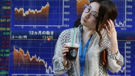 Asian shares climb as China posts steady growth, oil higher