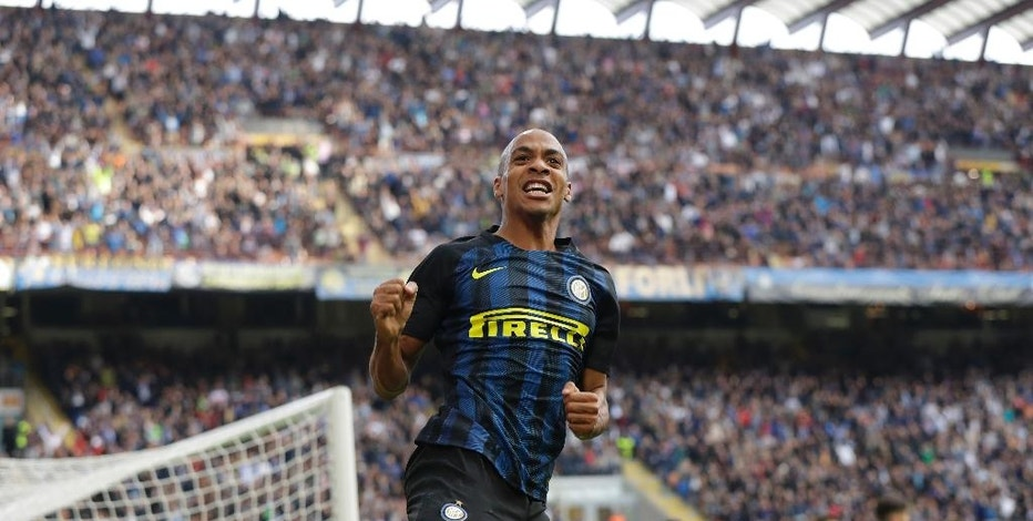 Inter Milan's Joao Mario celebrates after scoring during a Serie A soccer match between Inter Milan and Cagliari, at the San Siro stadium in Milan, Italy, Sunday, Oct. 16, 2016. (AP Photo/Luca Bruno)