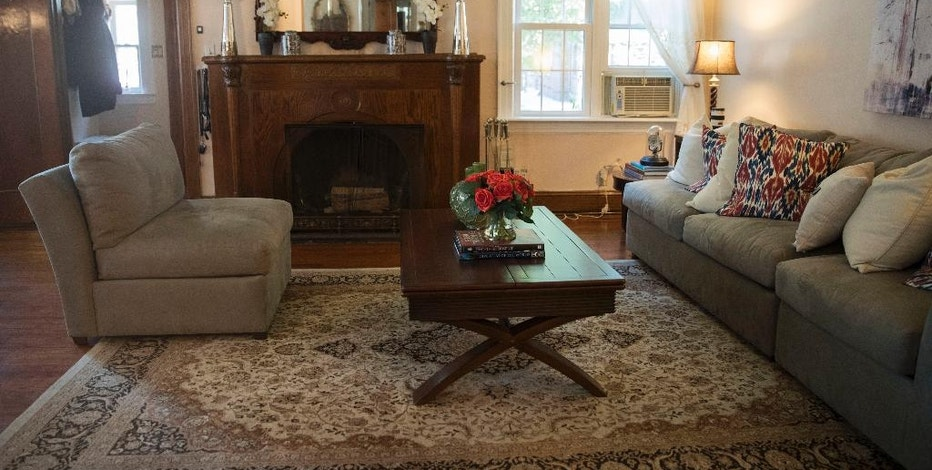 This Tuesday, Oct. 18, 2016 photo, shows the living room of the home where Republican presidential candidate Donald Trump spent his early childhood in the Jamaica Estates neighborhood of the Queens borough of New York. Trump's first boyhood home in New York City is going on the auction block with an opening bid of $849,000. (AP Photo/Mary Altaffer)