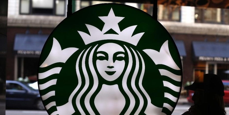 FILE - This Saturday, May 31, 2014, file photo, shows the Starbucks logo at one of the company's coffee shops in downtown Chicago. Starbucks is pushing ahead with its expansion into China and said it is on track to having about 5,000 stores there by 2021, more than doubling the number of coffee shops it currently has in the country. (AP Photo/Gene J. Puskar, File)