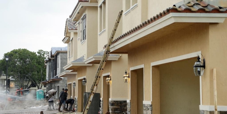 FILE - In this Thursday, Sept. 22, 2016, file photo, Lennar Corporation townhomes are under construction at Chelsea Place in Tamarac, Fla. On Wednesday, Oct. 19, 2016, the Commerce Department reports on U.S. home construction in September. (AP Photo/Lynne Sladky, File)
