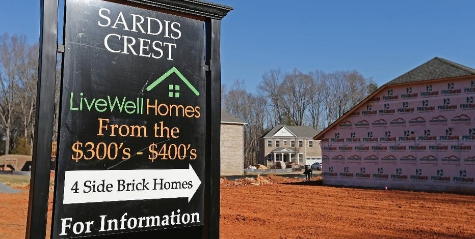 FILE - In this Jan. 8, 2015, file photo, new homes are under construction and for sale in Charlotte, N.C. Freddie Mac reports on the week's average U.S. mortgage rates, Thursday, Oct. 20, 2016. (AP Photo/Chuck Burton, File)