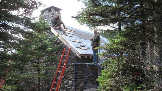 Historic mountaintop stone cabin gutted by fire is rebuilt