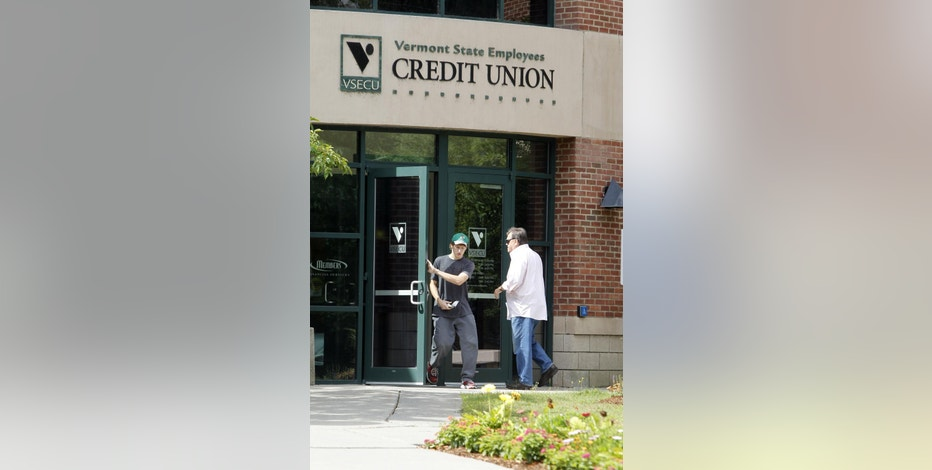FILE - In this July 27, 2012, file photo, customers enter the Vermont State Employees Credit Union in Montpelier, Vt. If you keep your money at a big national bank and the recent headlines about the fake-accounts scandal at Wells Fargo have you worried, it might be time to make a switch. Credit unions are similar to banks in their offerings, which include checking and savings accounts, credit cards and mortgages. Unlike banks, they have a mandate to serve their members, so they use their profits to provide lower fees and better interest rates. (AP Photo/Toby Talbot, File)