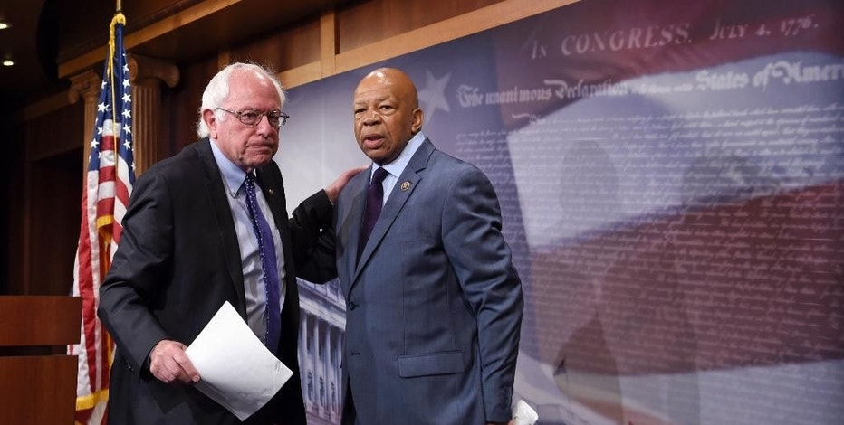 FILE - In this Sept. 10, 2015 file photo, Sen. Bernie Sanders, I-Vt., left, and Rep. Elijah Cummings, D-Md., leave a news conference on Capitol Hill in Washington. Sanders and Cummings on Thursday, Oct. 20, 2016, demanded information from a drug company that has raised prices on a leukemia drug, calling increases of tens of thousands of dollars a sign the company puts profits before patients. (AP Photo/Susan Walsh, File)