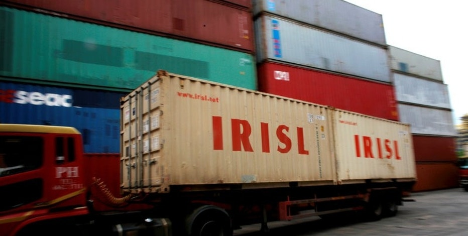 FILE PHOTO: A truck carrying Islamic Republic of Iran Shipping Lines (IRISL) containers arrives a depot in northern Singapore February 4, 2012. REUTERS/Thomas White/File Photo
