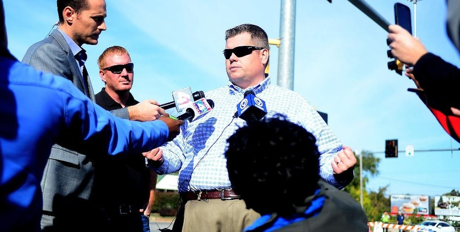 Trey Cocking, the city manager of Atchison, Kan., addresses the media after a chemical incident occurred at the MPG Ingredients plant on Friday Oct. 21, 2016, in Atchison, Kan. The Kansas Department of Emergency Management said multiple people who suffered respiratory problems because of the noxious cloud that formed were taken to hospitals. (Dougal Brownlie/The St. Joseph News-Press via AP)