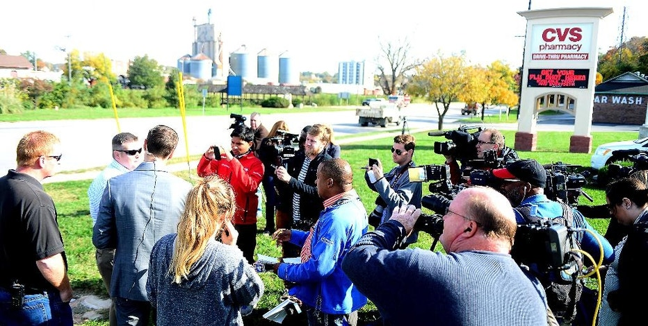 Trey Cocking, the city manager of Atchison, Kan., addresses the media outside of the CVS Pharmacy after a chemical incident occurred at the MPG Ingredients plant on Friday Oct. 21, 2016, in Atchison, Kan The Kansas Department of Emergency Management said multiple people who suffered respiratory problems because of the noxious cloud that formed were taken to hospitals. Their conditions have not been released.   (Dougal Brownlie/The St. Joseph News-Press via AP)