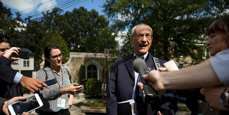 In this photo taken Oct. 5, 2016, Hillary Clinton's campaign manager John Podesta speaks to members of the media outside Democratic presidential candidate Hillary Clinton's home in Washington. Hacked emails show Hillary Clinton's campaign wrestled with how to announce her opposition to construction of the controversial Keystone XL pipeline without losing the support of labor unions that supported to project. Emails published this week by WikiLeaks show debate and confusion within the Clinton camp as it faced down the unexpectedly strong primary challenge by liberal Sen. Bernie Sanders, who opposed the pipeline.  (AP Photo/Andrew Harnik)