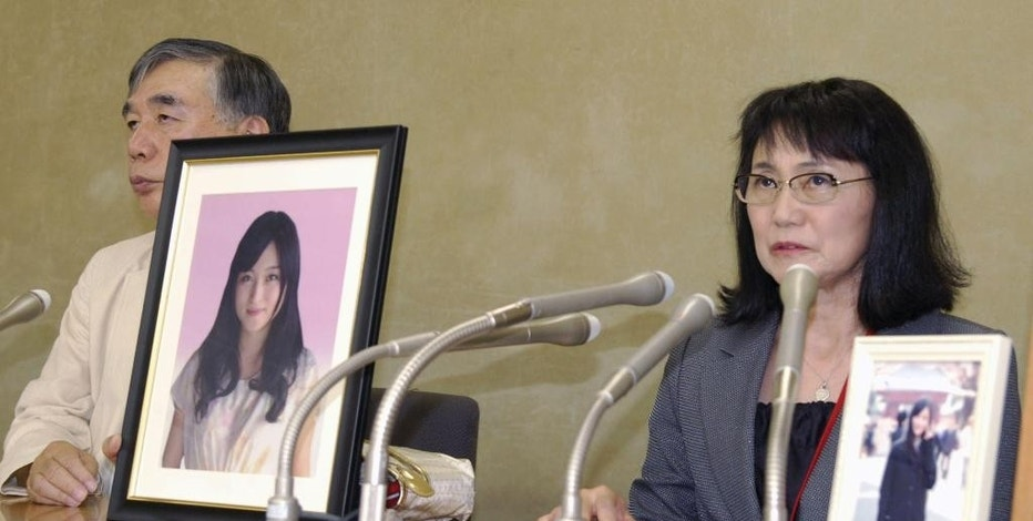 "In this Oct. 7, 2016 photo, Yukimi Takahashi, right, mother of Matsuri, with lawyer Hiroshi Kawahito, speaks to journalists at a news conference in Tokyo after her daughter's suicide was recognized as ""karoshi,"" or death from overwork. Matsuri Takahashi's dream career at Japan's top ad agency, Dentsu, ended with her suicide after her overtime exceeded 100 hours a month. (Kyodo News via AP)"