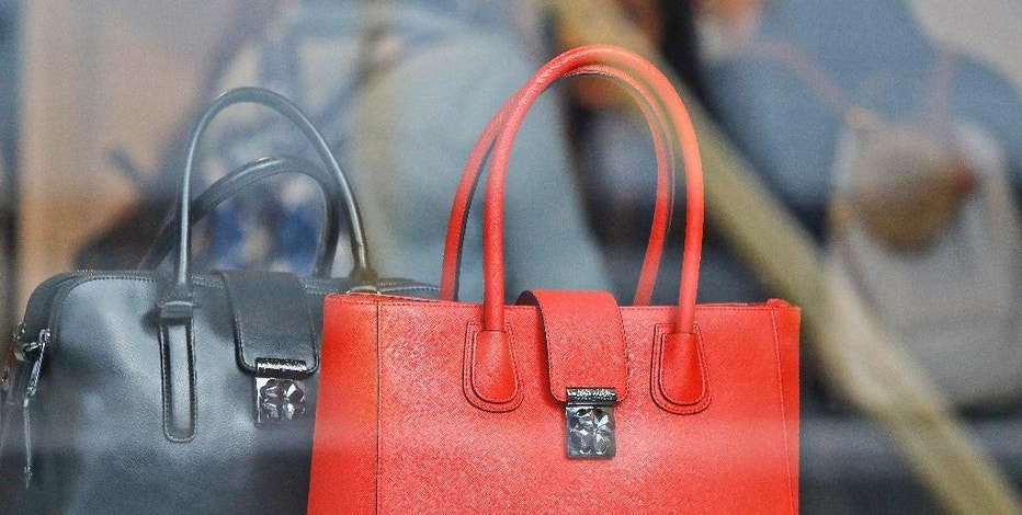 Women shop for bags in a luxurious outlet mall in London, Friday, Oct. 21, 2016. At the moment, the price is right in Britain, where the decision to leave the European Union has led to a sharp drop in the pound. That's proving a bonanza for luxury shoppers with foreign currency to spend. (AP Photo/Frank Augstein)