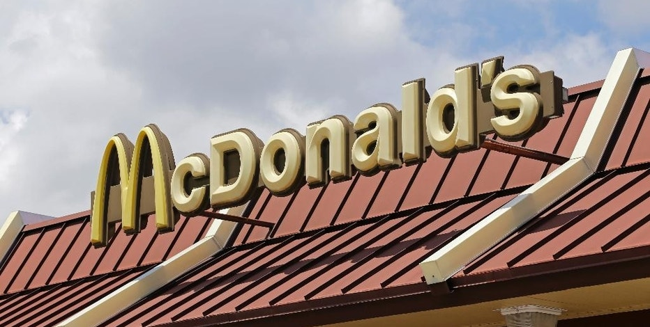 This Tuesday, June 28, 2016, photo shows a McDonald's sign atop one the chain's restaurants in Miami. McDonald's reports financial results Friday, Oct. 21, 2016. (AP Photo/Alan Diaz)