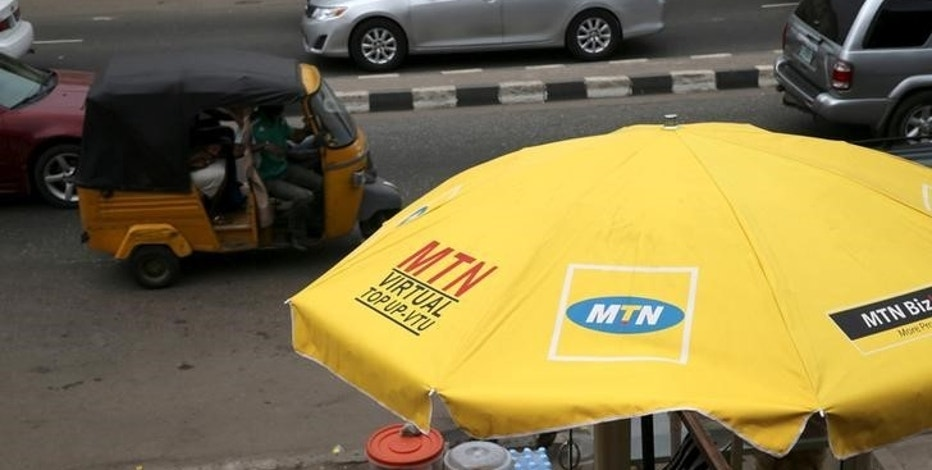 The logo of MTN telecommunication company is seen printed on an umbrella at a call point along a road in Lagos, Nigeria November 16, 2015. Picture taken November 16, 2015. REUTERS/Akintunde Akinleye/File Photo