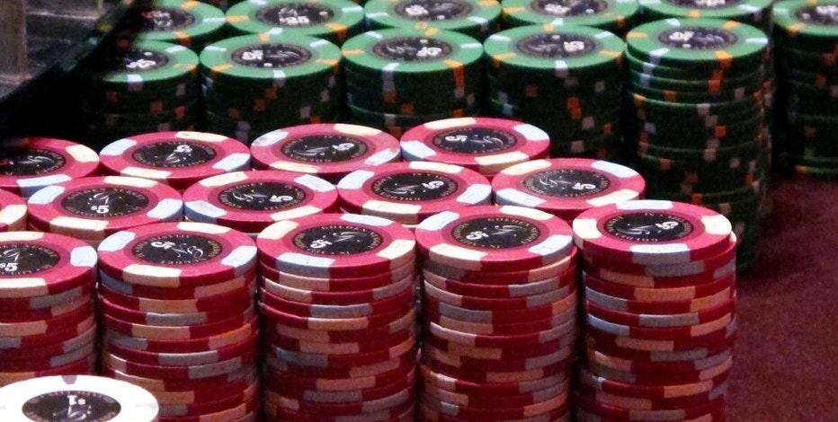 This June 24, 2016 photo shows gambling chips at the Golden Nugget casino in Atlantic City, N.J. A Newark real estate firm is proposing to build a casino on land it owns in New Jersey's largest city if voters approve a referendum to expand casino gambling beyond Atlantic City on Nov. 8, 2016. (AP Photo/Wayne Parry)