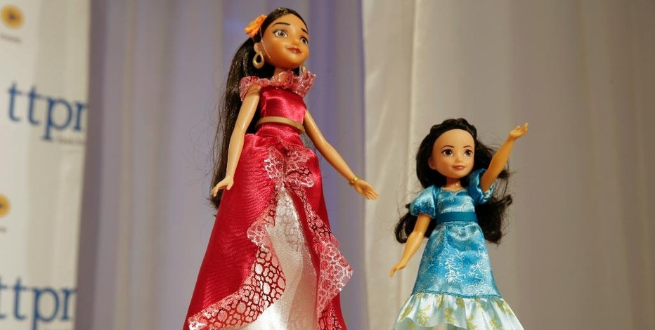 This Thursday, Oct. 6, 2016, photo shows Elena of Avalor, left, and Princess Isabel, from The Disney Store, on display at the annual TTPM Holiday Showcase, in New York. Toy companies are offering products that are more inclusive, from Barbie dolls in all shapes, sizes and skin tones to baby dolls aimed at boys. Toy companies are also offering dolls that represent different disabilities. But still experts and parents say more work needs to be done. (AP Photo/Richard Drew)