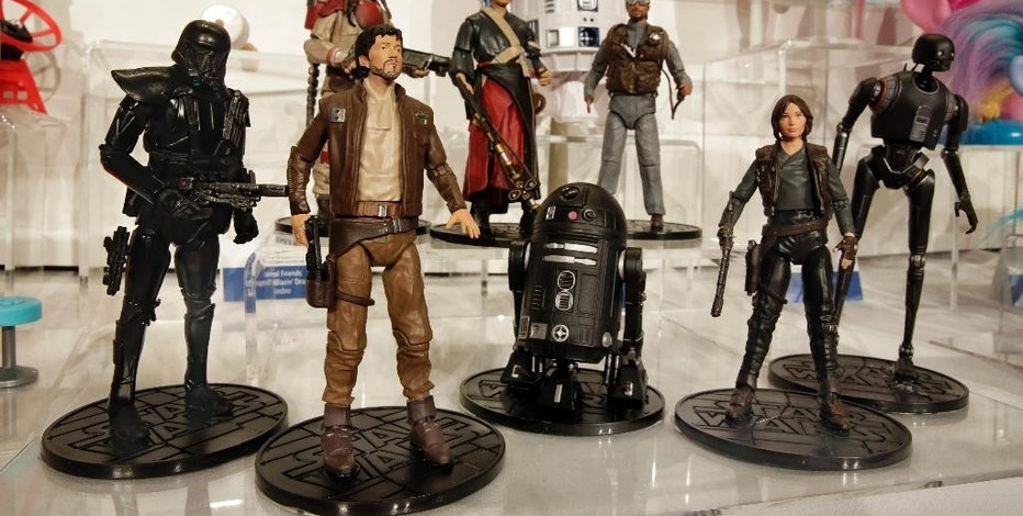 This Thursday, Oct. 6, 2016, photo shows the Star Wars Rogue One Elite Series characters, from The Disney Store, on display at the annual TTPM Holiday Showcase, in New York. Toy companies are offering products that are more inclusive, from Barbie dolls in all shapes, sizes and skin tones to baby dolls aimed at boys. Toy companies are also offering dolls that represent different disabilities. But still experts and parents say more work needs to be done. (AP Photo/Richard Drew)