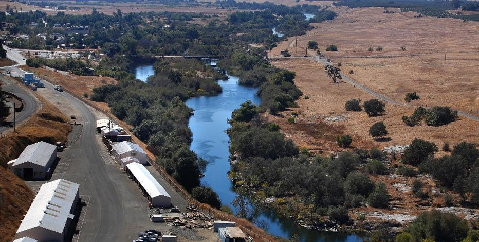 In this Oct. 5, 2016, photo, the first leg of the San Joaquin River restoration project is seen during a tour in Friant, Calif. A decade ago, environmentalists and the federal government agreed to revive a 150-mile stretch of California's second-longest river, an ambitious effort aimed at allowing salmon to again swim up to the Sierra Nevada foothills to spawn. (AP Photo/Gary Kazanjian)