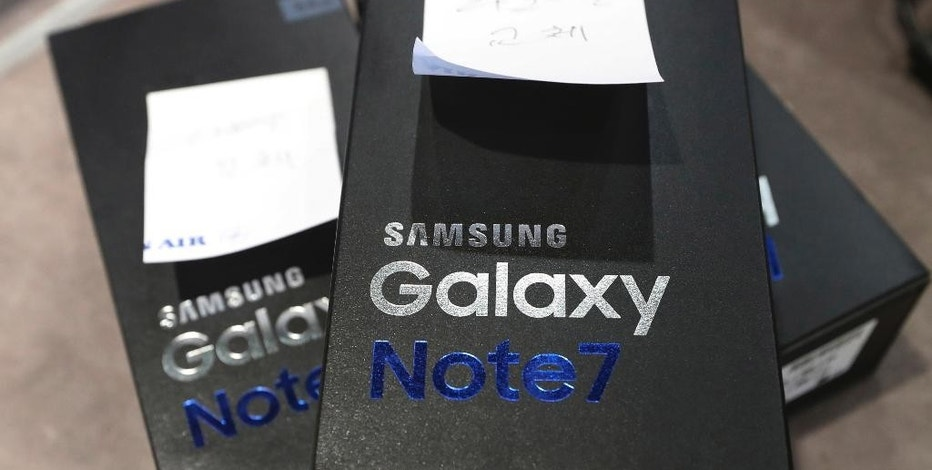 FILE - In this Thursday, Oct. 13, 2016, file photo, returned boxes of Samsung Electronics' Galaxy Note 7 smartphones are placed at a shop of South Korean mobile carrier in Seoul, South Korea. Hundreds of South Korean Galaxy Note 7 smartphone owners filed a lawsuit against Samsung Electronics on Monday, Oct. 24, 2016, over its handling of the fire-prone device in the first series of legal actions facing the South Korean tech giant at home. (AP Photo/Lee Jin-man, File)