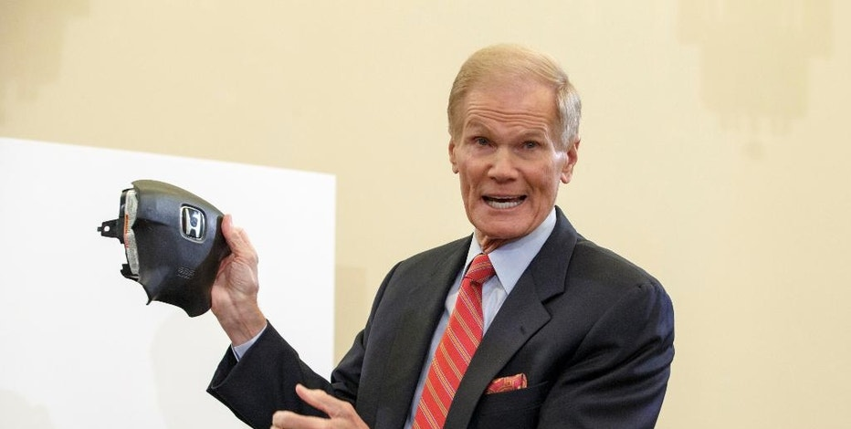 """FILE - In this Thursday, Nov. 20, 2014, file photo, Senate Commerce Committee member Sen. Bill Nelson, D-Fla., displays the parts and function of a defective airbag made by Takata of Japan that has been linked to multiple deaths and injuries in cars driven in the United States, during the committee's hearing on Capitol Hill in Washington. Despite thousands of mailed notices and warnings of grave danger, since June 2016, Honda is still struggling to fix 300,000 cars with super-dangerous Takata air bag inflators inside their steering wheels. Nelson says Honda should do more. """"No responsible automaker should be so slow in repairing defective vehicles where there's up to a 50 percent chance a driver could be killed or seriously injured if an air bag deploys,"""" he said in a statement. (AP Photo/J. Scott Applewhite, File)"""
