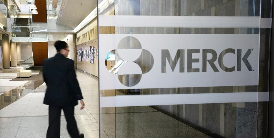 FILE - In this Thursday, Dec. 18, 2014, file photo, a person walks through a Merck company building, in Kenilworth, N.J. Merck reports financial results Tuesday, Oct. 25, 2016. (AP Photo/Mel Evans, File)