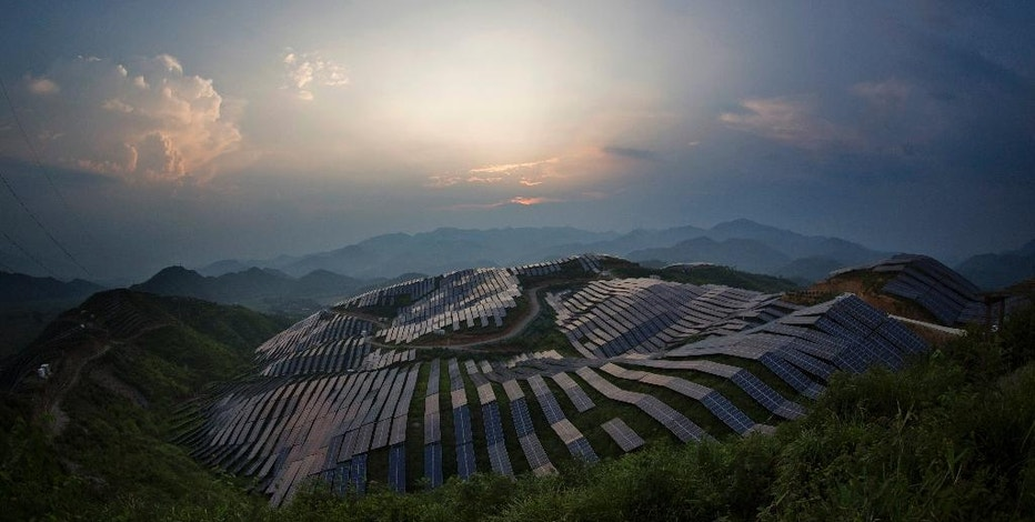 This Aug. 21, 2016 photo shows a view of a photovoltaic power station in Songxi county in southeast China's Fujian province. Solar panels are among a series of industries from steel and cement to wind turbines in which Chinese production capacity soared during the past decade's economic boom until it vastly exceeded demand. (Chinatopix via AP)