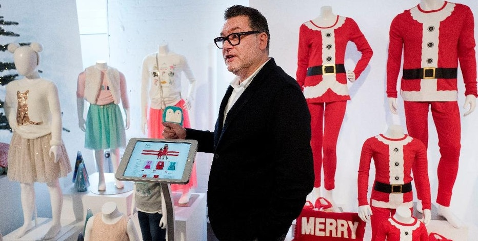 Mark Tritton, executive vice president and chief merchandising officer for Target, discusses some of the holiday products to be offered by the retailer, Tuesday, Oct. 25, 2016, in New York. Target is heading into the critical holiday season a little bruised after it saw customer traffic and a key revenue measure fall in the second quarter after a string of quarterly gains. (AP Photo/Mark Lennihan)