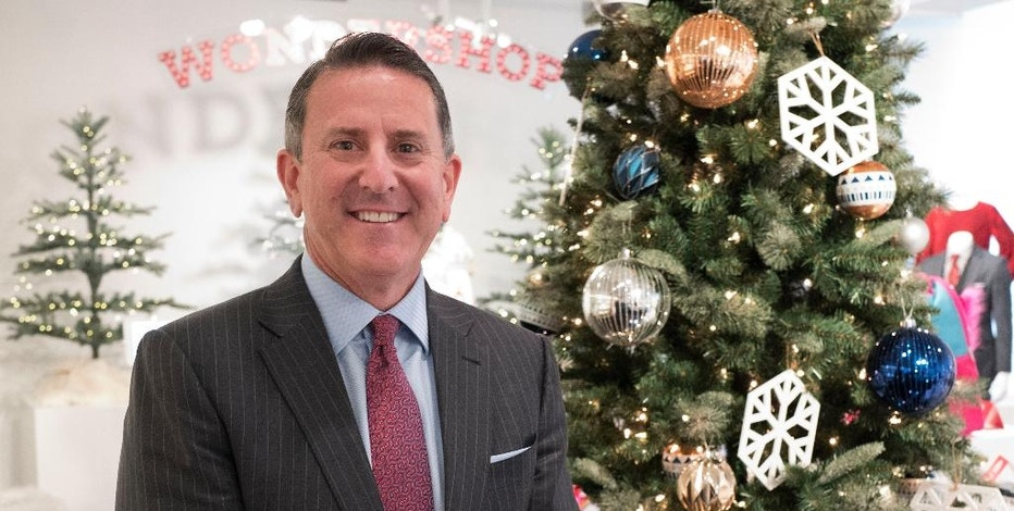 Target Chairman and CEO Brian Cornell poses with a Christmas tree during a media presentation, Tuesday, Oct. 25, 2016, in New York. Since assuming the CEO post in August 2014, Cornell has been trying to reinvigorate Target's cheap-chic status and focus on categories like fashion, home furnishings and wellness items. (AP Photo/Mark Lennihan)
